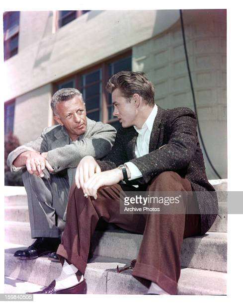 Director Nicholas Ray sits with James Dean on set of the film 'Rebel Without A Cause' 1955