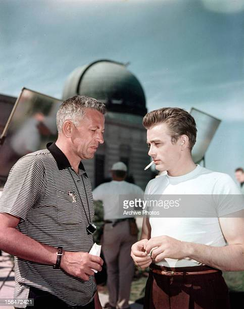 Director Nicholas Ray talking to James Dean at the Griffith Park Observatory in between scenes from the film 'Rebel Without A Cause' 1955