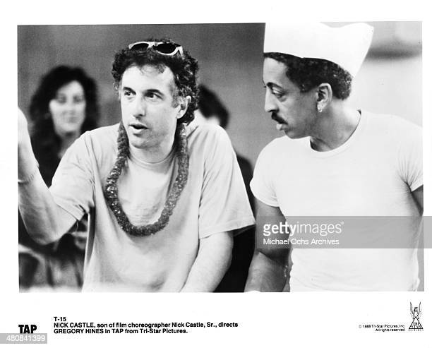 Director Nick Castle and actor Gregory Hines talk on the set of the movie Tap circa 1989