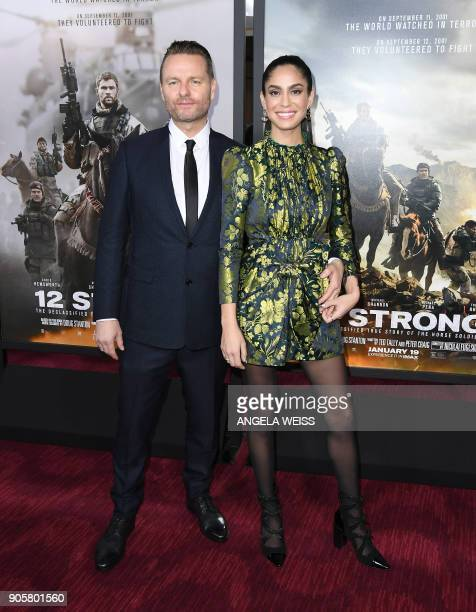 Director Nicolai Fuglsig and guest attend the world premiere of '12 Strong' at Jazz at Lincoln Center on January 16 in New York City / AFP PHOTO /...