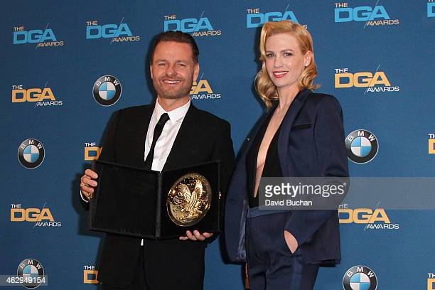 Director Nicolai Fuglsig , winner of the Outstanding Directorial Achievement in Documentary for Commercials, poses with actress January Jones in the...