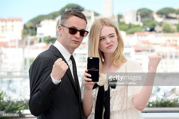 """Director Nicolas Winding Refn and actress Elle Fanning attend """"The Neon Demon"""" Photocall during the 69th annual Cannes Film Festival at the Palais..."""