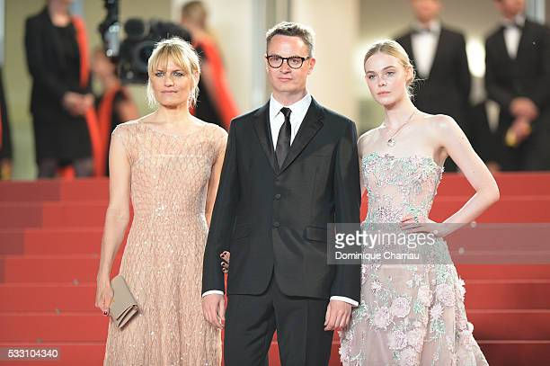 """Director Nicolas Winding Refn his wife, actress Liv Corfixen and actress Elle Fanning attend the """"Neon Demon"""" premiere during the 69th annual Cannes..."""