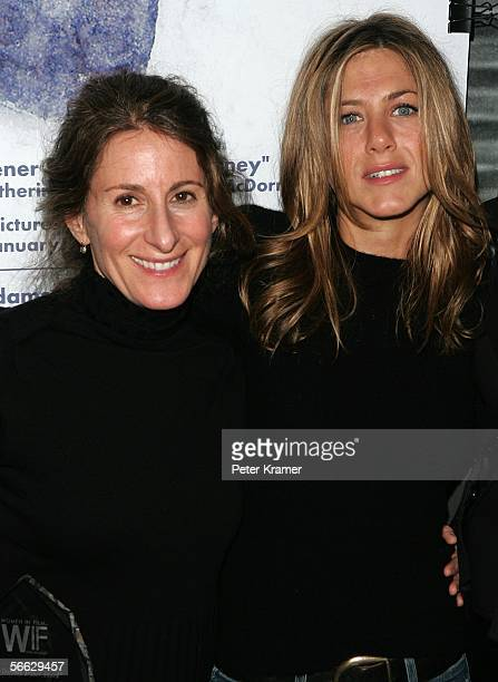 Director Nicole Holofcener and actress Jennifer Aniston pose for photos at the Women in Film and the cast of Friends with Money press conference at...