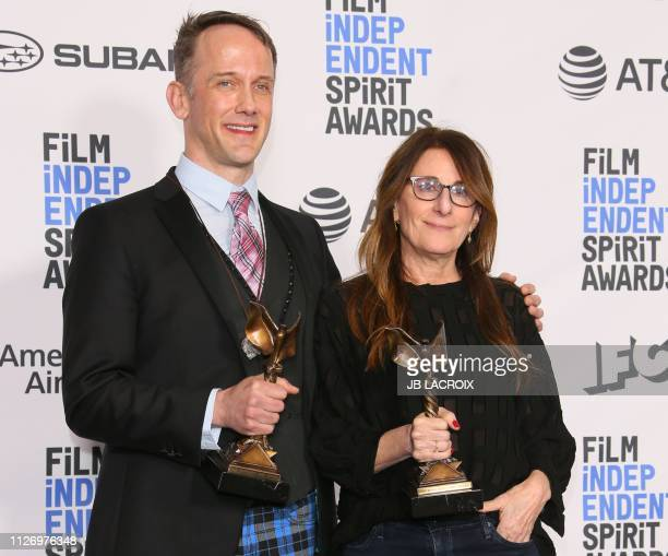 Director Nicole Holofcener and Playwright Jeff Whitty pose in the press room with the award for Best Screenplay in Can You Ever Forgive Me during the...