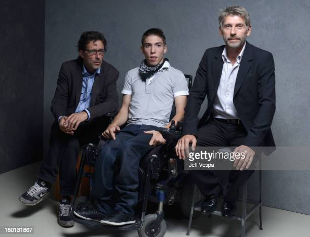 Director Nils Tavernier actor Fabien Heraud and actor Jacques Gamblin of 'The Finishers' pose at the Guess Portrait Studio during 2013 Toronto...
