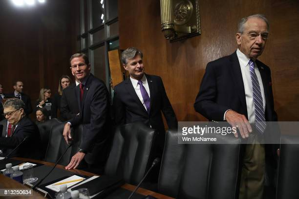 FBI director nominee Christopher Wray escorted by committee chairman Chuck Grassley arrives at his confirmation hearing before the Senate Judiciary...
