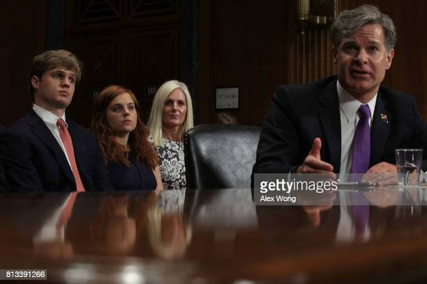 Director nominee Christopher Wray testifies as his wife Helen son Trip and daughter Caroline look on during his confirmation hearing before the...