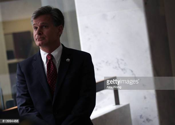 Director nominee Christopher Wray waits in a hallway prior to his meeting with US Sen Mark Warner on Capitol Hill July 13 2017 in Washington DC If...
