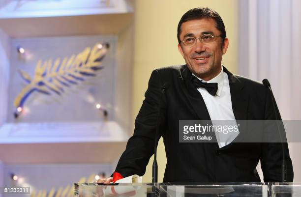 Director Nuri Bilge Ceylan accepts the Best Director Award for 'Three Monkeys' during the Palme d'Or Closing Ceremony at the Palais des Festivals...