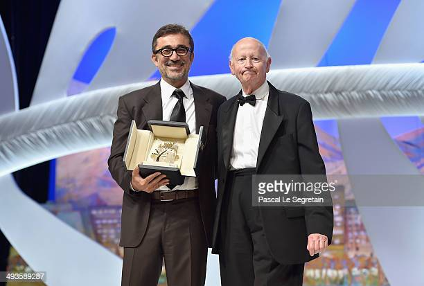 Director Nuri Bilge Ceylan poses on stage with Gilles Jacob after winning the Palme d'Or for his film 'Winter's Sleeps' during the Closing Ceremony...
