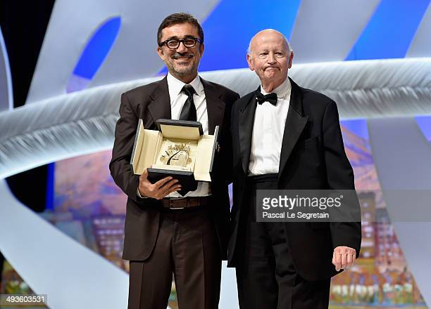 Director Nuri Bilge Ceylan poses on stage with the President of the Cannes Film Festival Gilles Jacob after being awarded with the Palme d'Or for the...
