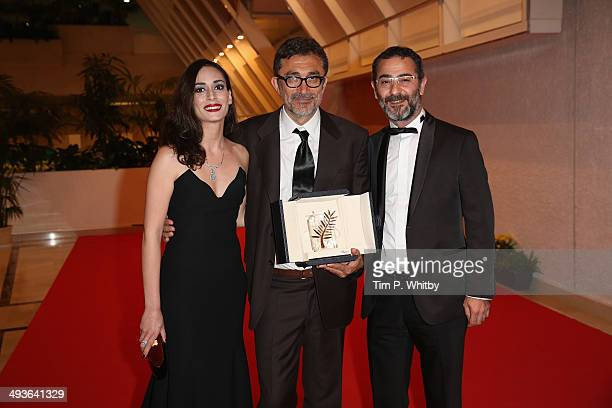 Director Nuri Bilge Ceylan winner of the Palme d'Or Prize for his film 'Winter Sleep' poses with actors Melisa Sozen and Ayberk Pekcan as they attend...