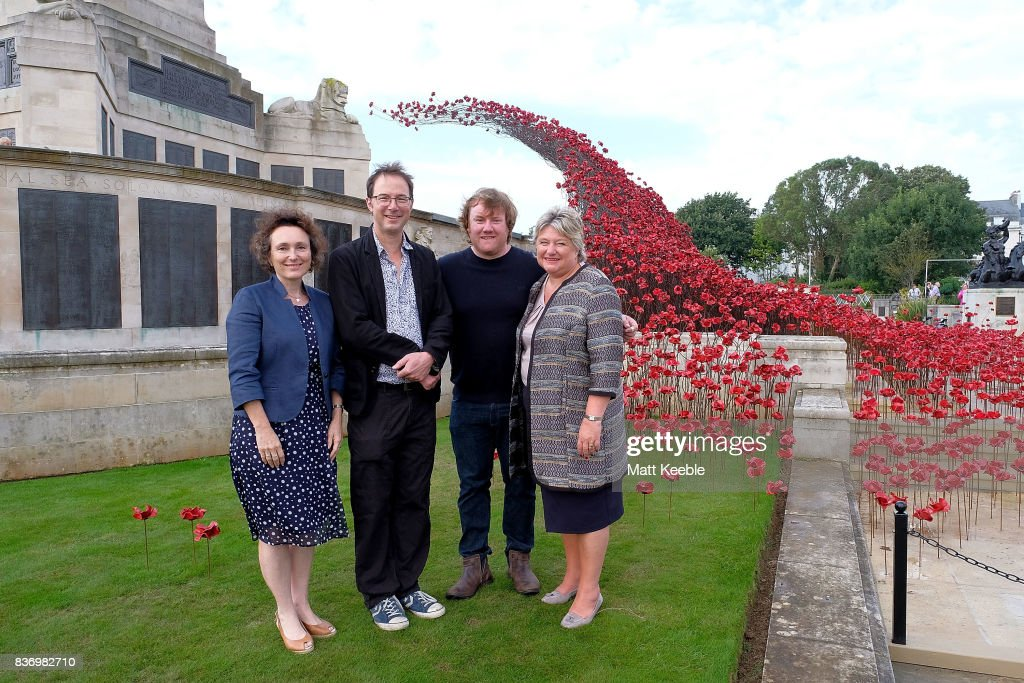 Director of 14-18 NOW Jenny Waldman, Designer Tom Piper, Artist Paul Cummins and Director General of CWGC Victoria Wallace attend the poppy sculpture 'Wave' opening at the CWGC Naval Memorial, as part of a UK wide tour organised by 14-18 NOW on August 22, 2017 in Plymouth, England.