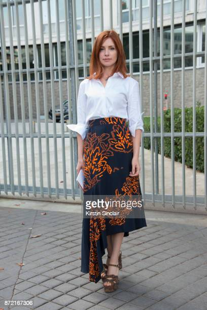 Director of accessories at Selfridges Eleanor Robinson wears a Peter Pilotto shirt Theory skirt and Saint Laurent shoes day 4 of Paris Womens Fashion...