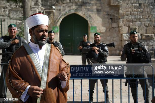 Director of alAqsa Mosque Omar AlKeswani delivers a speech before the afternoon prayer in front of the Lions' Gate after Israeli forces entered East...