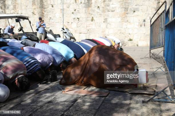 Director of alAqsa Mosque Omar AlKeswani leads the afternoon prayer in front of a barricade at the Lions' Gate after Israeli forces entered East...
