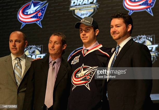 Director of Amateur Scouting Tyler Wright Paul Castron and Ryan Murray drafted second overall by the Columbus Blue Jackets pose on stage during Round...