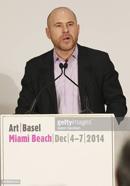 Director of Art Basel Marc Spiegler speaks at a press conference during Art Basel Miami Beach 2014 VIP Preview at the Miami Beach Convention Center...