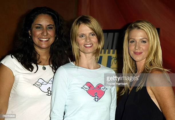 Director of Artists for Amnesty Bonnie Abaunza with Fashion Designer Tracy Wilkinson and Actress Poppy Montgomery pose together at Cafe La Boheme...
