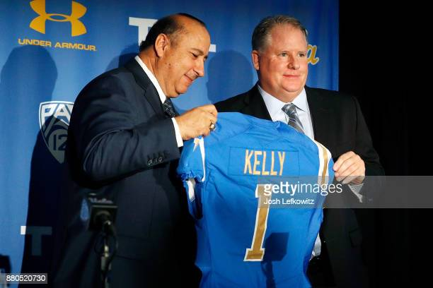 Director of Athletics Dan Guerrero and Chip Kelly hold up a jersey during a press conference introducing Kelly as the new UCLA Football head coach on...