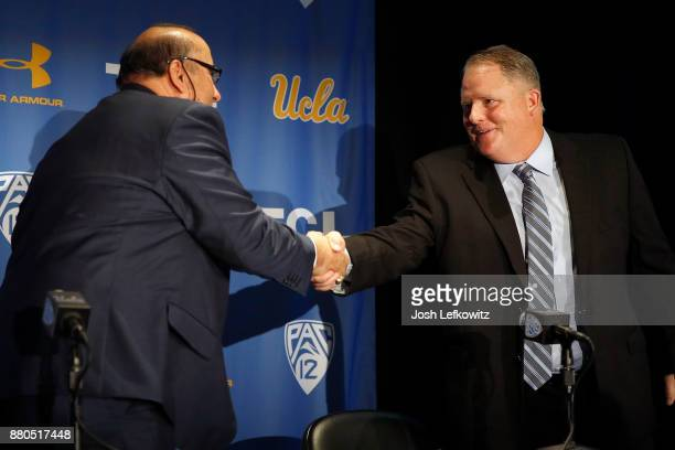 Director of Athletics Dan Guerrero and Chip Kelly shake hands after a press conference introducing Kelly as the new UCLA Football head coach on...