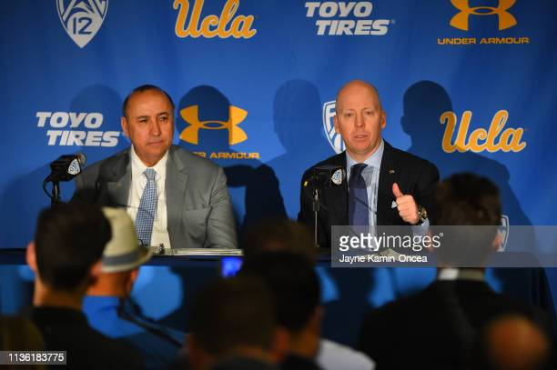 Director of Athletics Dan Guerrero listens as Mick Cronin speaks to the media after he was introduced as the new UCLA Mens Head Basketball Coach at...