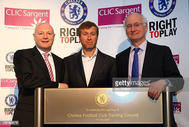 Director of Chelsea Peter Kenyon Roman Abramovich the owner of Chelsea and Chairman Bruce Buck unveil a plaque during the Chelsea Training Ground...