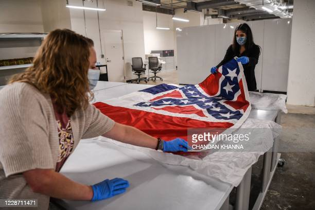 Director of Collections Museum Division Nan Prince pulls out the Mississippi's flag from the state's capitol for showcase at the Mississippi...
