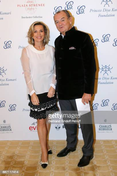 Director of Communication at Plaza Athenee Hotel Isabelle Maurin and Founder of the Cooking Chefs' Club of the Heads of States Gilles Bragard attend...