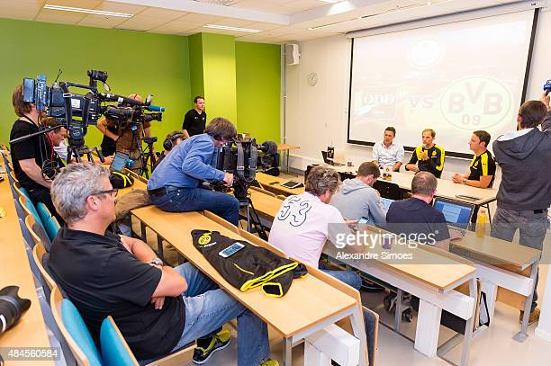 Director of Communication Sascha Fligge and head coach Thomas Tuchel of Borussia Dortmund are answering questions at the training's press conference...