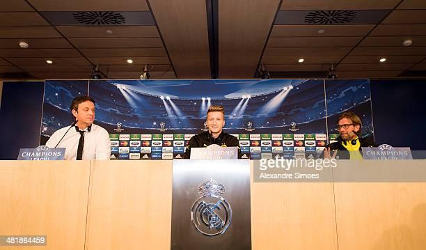 Director of communications Sasha Fligge of Borussia Dortmund Marco Reus of Borussia Dortmund and head coach Juergen Klopp of Borussia Dortmund attend...
