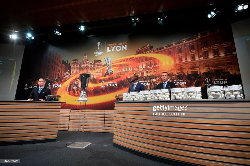 UEFA director of competitions Giorgio Marchetti, French former international Eric Abidal and UEFA head of club competitions Michael Heselschwerdt take part in the draw for the round of 32 of the UEFA Europa League football tournament at the UEFA headquarters in Nyon on December 11, 2017. / AFP PHOTO / Fabrice COFFRINI