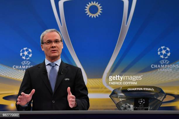 UEFA director of competitions Giorgio Marchetti gestures as he speaks at the start of the draw for the quarter finals round of the UEFA Champions...