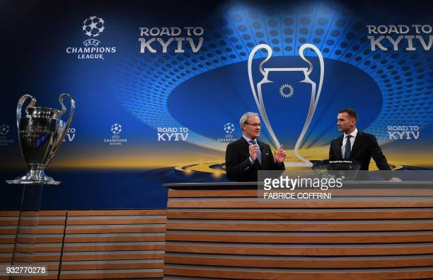 UEFA director of competitions Giorgio Marchetti gestures as he speaks with Former Ukrainian football player and ambassador for the UEFA Champion...