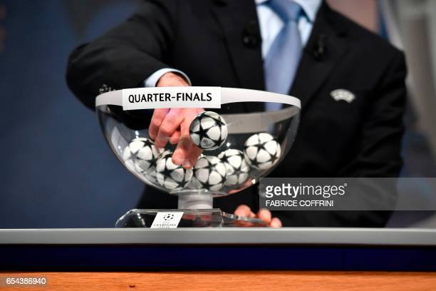 UEFA director of competitions Giorgio Marchetti prepares to make a selection during the ceremony for the quarterfinal draw of the quarterfinal draw...
