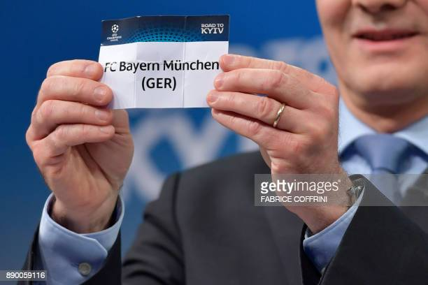 UEFA director of competitions Giorgio Marchetti shows the slip of Bayern Munich during the draw for the round of 16 of the UEFA Champions League...
