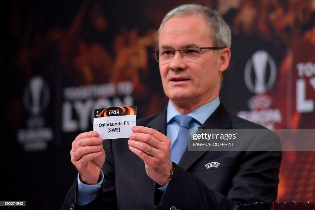 UEFA director of competitions Giorgio Marchetti shows the slip of Ostersunds FK during the draw for the round of 32 of the UEFA Europa League football tournament at the UEFA headquarters in Nyon on December 11, 2017. / AFP PHOTO / Fabrice COFFRINI / The erroneous mention[s] appearing in the metadata of this photo by Fabrice COFFRINI has been modified in AFP systems in the following manner: [UEFA director of competitions Giorgio Marchetti] instead of [French former international Eric Abidal ]. Please immediately remove the erroneous mention[s] from all your online services and delete it (them) from your servers. If you have been authorized by AFP to distribute it (them) to third parties, please ensure that the same actions are carried out by them. Failure to promptly comply with these instructions will entail liability on your part for any continued or post notification usage. Therefore we thank you very much for all your attention and prompt action. We are sorry for the inconvenience this notification may cause and remain at your disposal for any further information you may require.