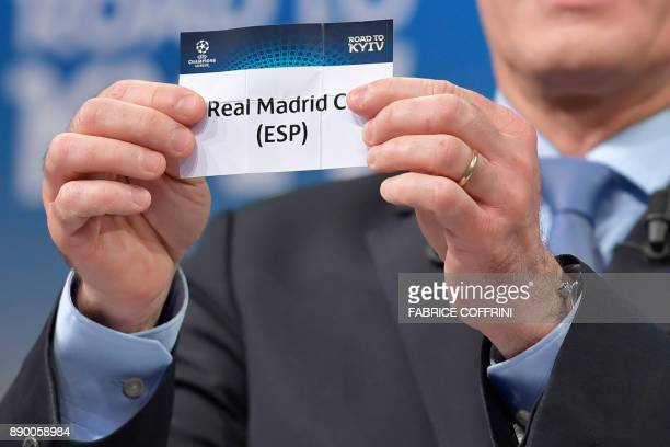 UEFA director of competitions Giorgio Marchetti shows the slip of Real Madrid during the draw for the round of 16 of the UEFA Champions League...