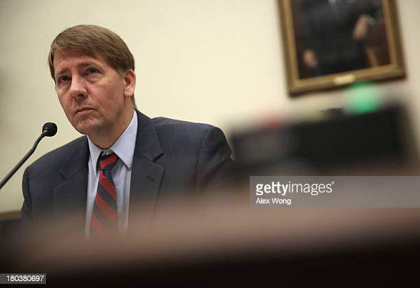 Director of Consumer Financial Protection Bureau Richard Cordray testifies during a hearing before the House Financial Services Committee September...