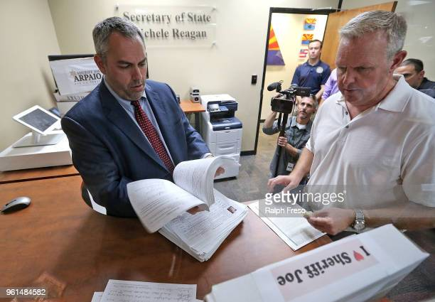 Director of Election Services Eric Spencer sorts through stacks of petitions submitted by former Maricopa County Sheriff Joe Arpaio at the Arizona...