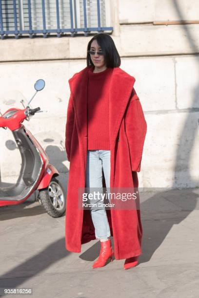 Director of fashion partnerships at Instagram Eva Chen wears a Max Mara coat Gentle monster sunglasses Alexandre Birman shoes Carolina Herrera bag...