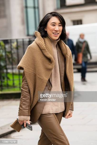 Director of fashion partnerships at Instagram Eva Chen wears Petar Petrov trousers and jacket and Ninety Percent jumpers during London Fashion Week...