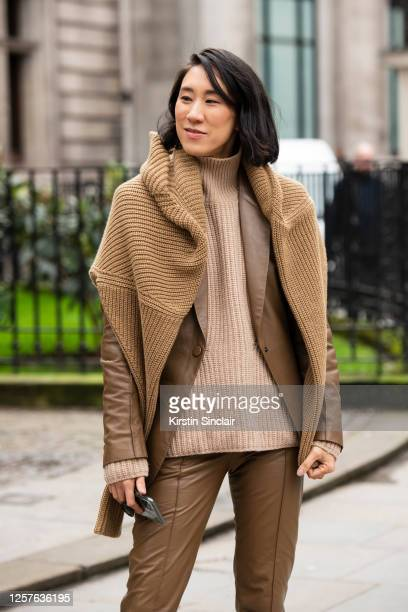 Director of fashion partnerships at Instagram Eva Chen wears Petar Petrov trousers and jacket, Ninety Percent jumpers during London Fashion Week...