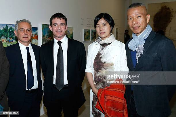 Director of 'Fondation Cartier' Herve Chandes French Prime Minister Manuel Valls Contemporary artist GuoQiang Cai and his assistant attend the...