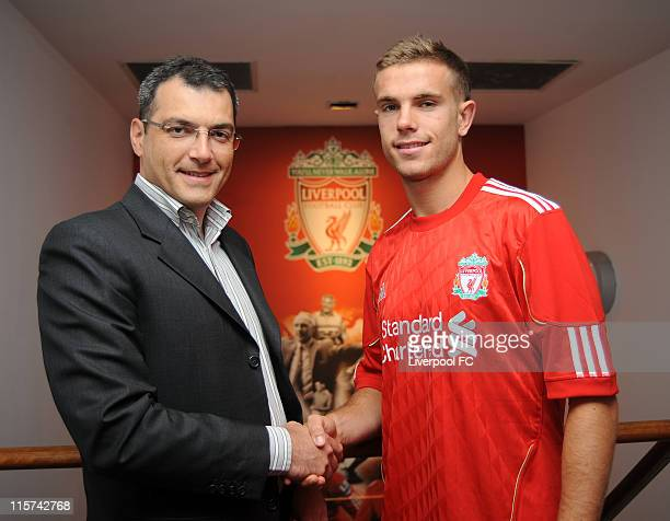 Director of Football for Liverpool Damien Comolli stands by Jordan Henderson as he signs for Liverpool FC at Melwood Training Ground on June 8 2011...