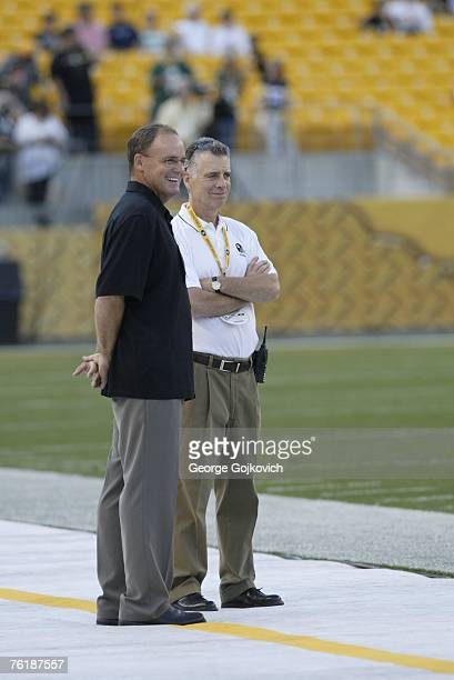 Director of Football Operations Kevin Colbert of the Pittsburgh Steelers stands near team owner Arthur J Rooney II on the field before a preseason...