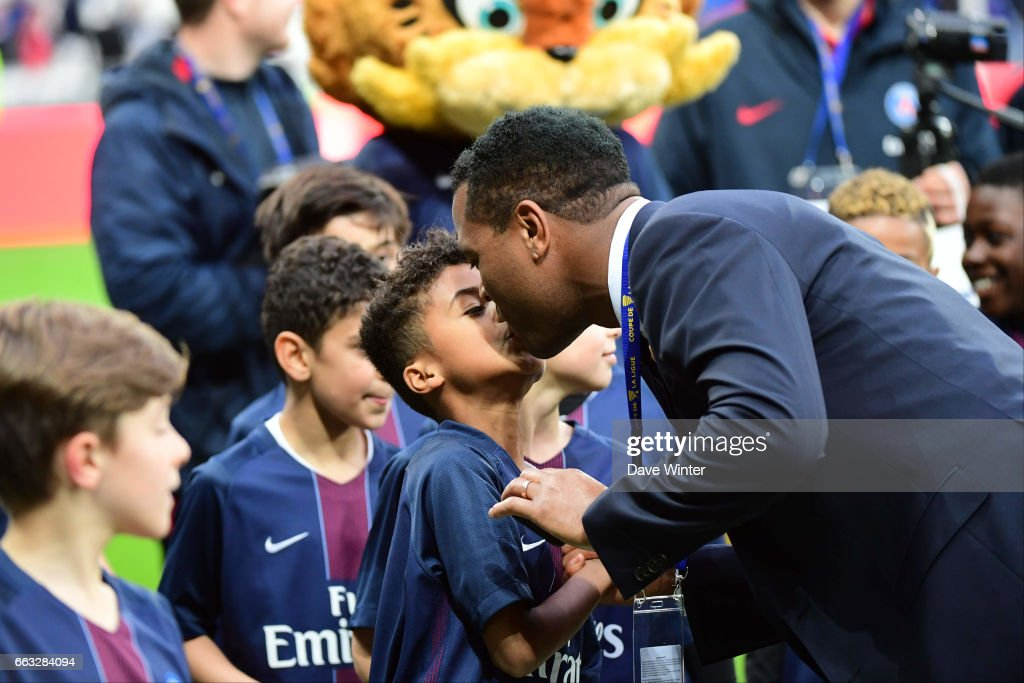PSG director of football Patrick Kluivert greets his son Shane Patrick, who played in the under 9s game before the French League Cup Final between Paris Saint Germain and Monaco at Parc Olympique on April 1, 2017 in Lyon, France.