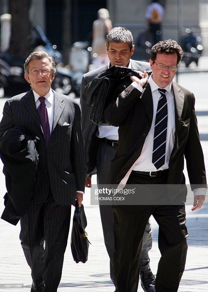 Director of French bank Societe Generale's corporate and investistment banking branch Christophe Mianne (C) arrive with his lawyers Jean Renhart (R) and Francois Martineau (L), on July 23, 2008 in Paris, as he arrives at the financial investigation unit of Paris courthouse prior to a hearing with rogue trader Jerome Kerviel as part of the inquiry into the Societe Generale's multi-billion-euro losses. Kerviel, 31, was involved in deals which the French bank says cost more than seven billion dollars in the biggest known rogue trading scam.