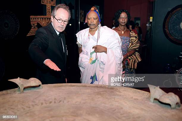 Director of French patrimony and collections at the Quai Branly primitive arts museum Yves Le Fur explains to King Behanzin of Benin a piece...
